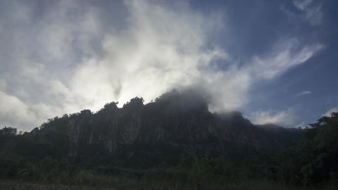 Timelapse morning cloud, mist appear at the top of the hill in morning Live Action