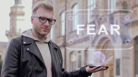 Smart young man shows hologram Fear Live Action