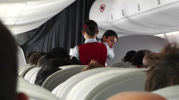 Flight Attendants Serving Meals on Flight Stock Video Footage