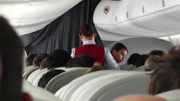 Flight Attendants Serving Meals on Flight Stock Video Footage