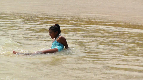 Tropical Paradise in Mexico 9 girls playing in the beach Stock Video Footage