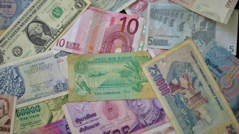4k UHD world money dolly move 10884 Stock Video Footage