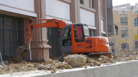 Excavator working on construction site Stock Video Footage