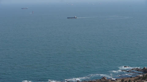 Overlook Sea & Ship Traveling Over Sparkling Waves. stock footage