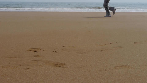 running on beach Stock Video Footage