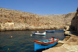 Brightly painted Maltese boats on blue water in summer, Malta フォト