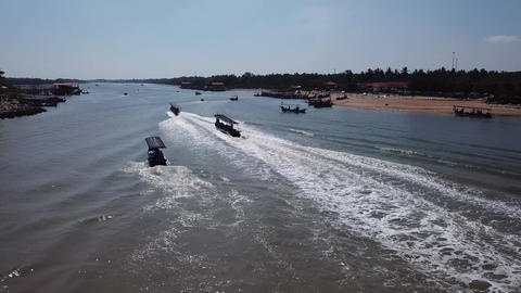 Follow back fishing boats back to fishing village Live Action
