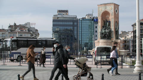 Police vehicles and Republic Monument at Taksim Square Live Action