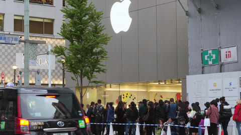 Lots of people waiting outside the Apple store in Tokyo Japan Live Action