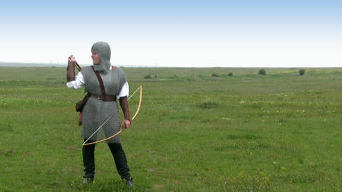 Medieval warrior - girl shoots a bow Stock Video Footage