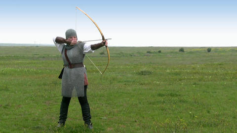 Medieval Warrior - Girl Shoots A Bow stock footage