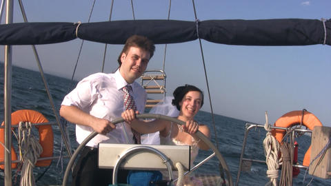 Young couple for yacht steering wheel Stock Video Footage