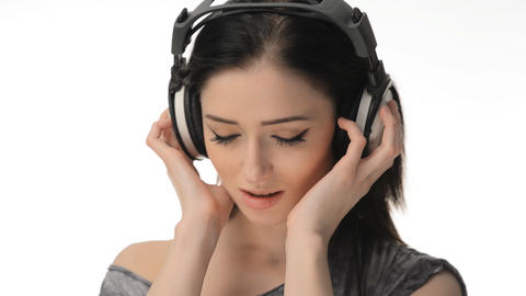 Young beautiful sexy girl listening to music on headphones Footage