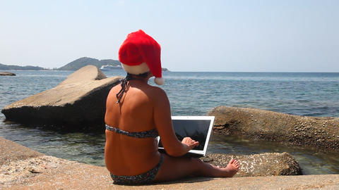 Woman using laptop on the beach Stock Video Footage