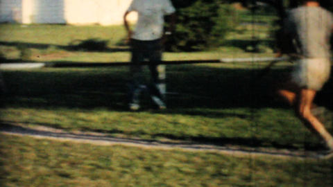 Man Perfects His Pole Vaulting In Backyard 1962 Vintage... Stock Video Footage