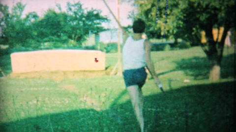 Young Man Practising Pole Vaulting In Backyard 1962... Stock Video Footage