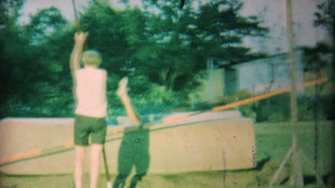 Young Man Practising Pole Vaulting In Backyard 1962 Vintage 8mm film Footage