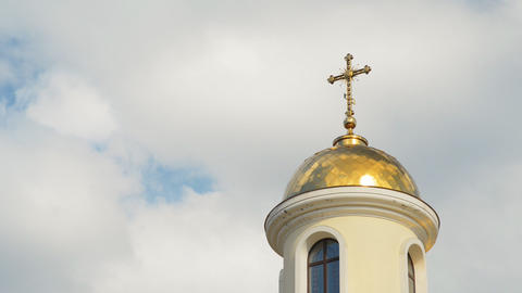 The dome of the church on a cloudy sky (time lapse Stock Video Footage
