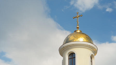 The dome of the church on a cloudy sky (time lapse Footage