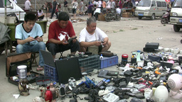 Men Selling Mobile Phones At A Second Hand Market stock footage