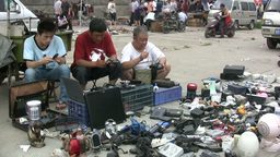 Men selling mobile phones at a second hand market Stock Video Footage