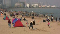 People on the beach in Chinese city Stock Video Footage
