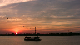 Tourist Boat Sails Over Chinese River At Sunset stock footage