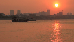 Cargo ship sails the Pearl river at sunset in Guan Stock Video Footage