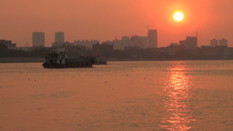 Cargo ship sails the Pearl river at sunset in Guan Footage