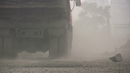 Extreme pollution in China - Coal truck drives thr Stock Video Footage