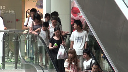Shoppers using escalators in a mall in Guangzhou Stock Video Footage
