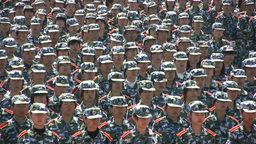 Faces of Chinese students during military performa Stock Video Footage