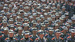 Faces of Chinese students during military performa Footage