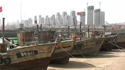 Huge construction site behind fishing ships in Chi Footage