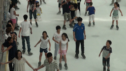 Kids are ice skating at a rink in a Chinese shoppi Stock Video Footage