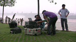 Chinese journalists before Three Gorges Dam Stock Video Footage