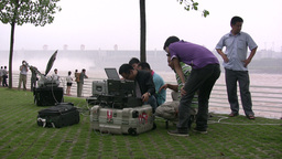 Chinese Journalists Before Three Gorges Dam stock footage