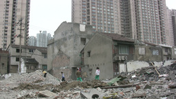 Kids play among destroyed quarter in China Stock Video Footage