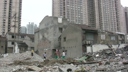 Kids play among destroyed quarter in China Footage
