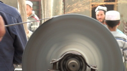 Sharpening knives in an Uyghur village in China Stock Video Footage