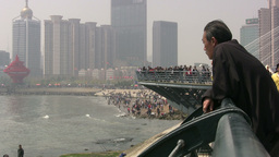 China - a man is looking out over a changed city Stock Video Footage