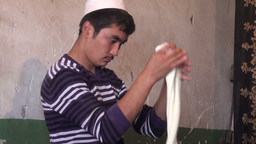 Young Uyhgur man is making the dough for noodles Stock Video Footage