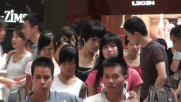 People on escalators closeup in Guangzhou shopping Stock Video Footage