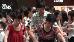People on escalators closeup in Guangzhou shopping Footage