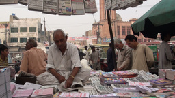 A man sells newspaper on the streets Stock Video Footage