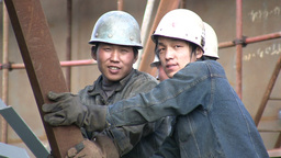 Shipyard workers are laughing and look into the ca Stock Video Footage