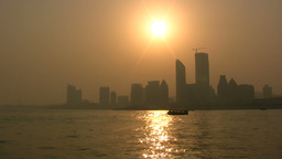 A tourist boat sails in front of the skyline of Qi Stock Video Footage