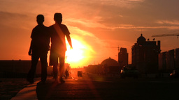 Two Chinese men walk through a street at a beautif Stock Video Footage