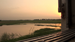 Riding the train at sunset through Sindh province, Stock Video Footage