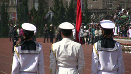 Student military parade - white uniforms and flag Stock Video Footage